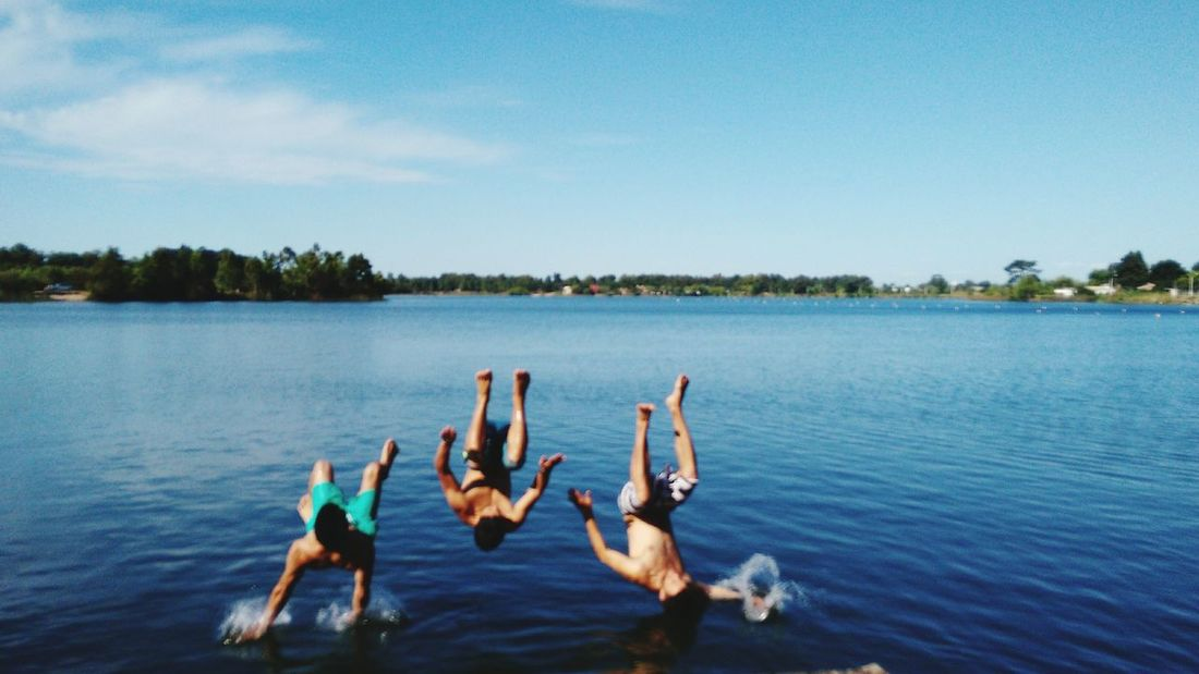 Togetherness Water Full Length Sky Horizontal People Lake Person Outdoors Day Adult Swimming Men Friendship Nature Young Adult Human Body Part