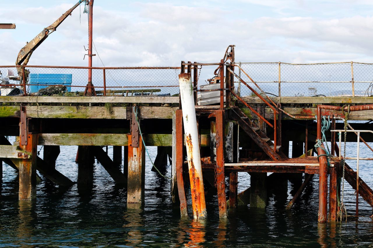 Boardwalk Day Hanging Around Just Hanging Around No People Outdoors Pier Rough Rusty Sea Silence Water Waterfront Wooden Working Area