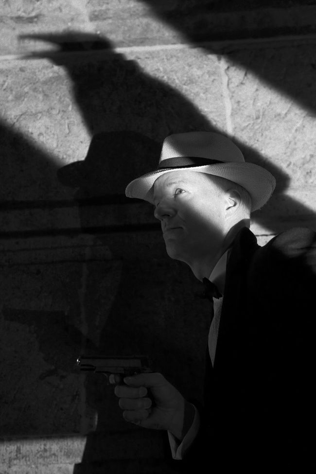 vintage film noir style gangster with a raven shadow Actor Blackandwhite Cinema In Your Life Cosplay Fedora  Film Noir Gangster Gun Monochrome MOVIE Raven Retro Shadow Silhouette The Portraitist - 2016 EyeEm Awards Vintage Man Model Cinema Thriller