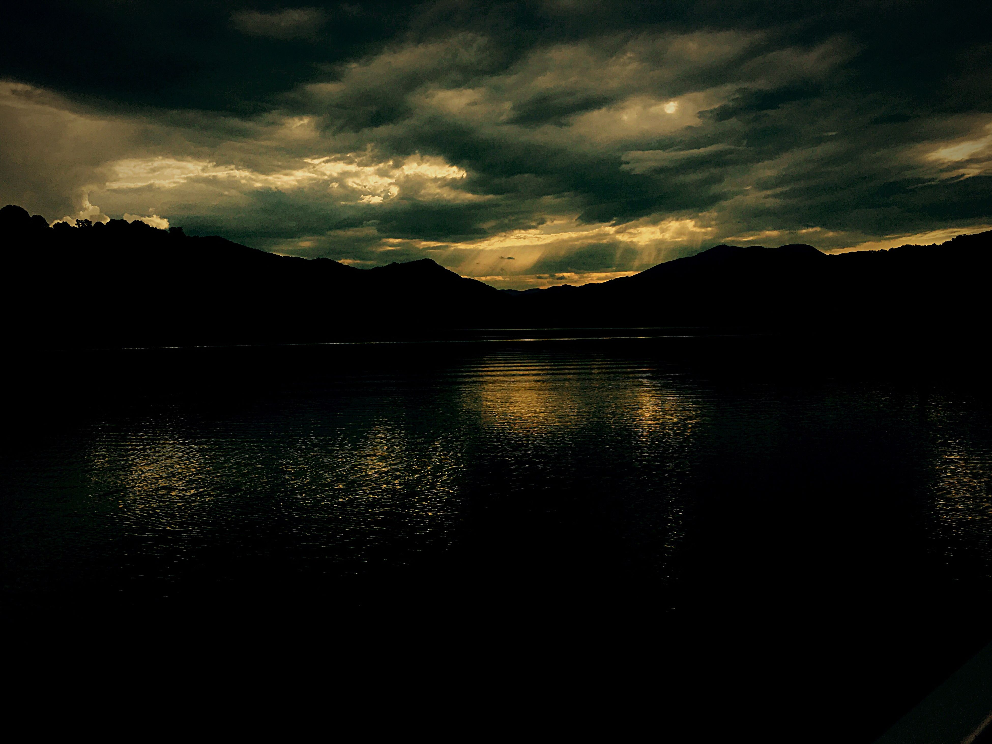 mountain, water, sky, scenics, tranquil scene, sunset, tranquility, mountain range, beauty in nature, cloud - sky, lake, nature, idyllic, cloud, calm, dark, outdoors, no people, cloudy, non-urban scene, remote, landscape, majestic