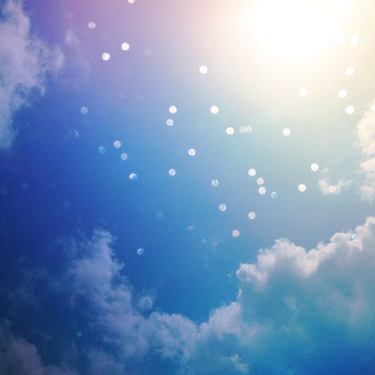 sunshine won't stop rain rain cannot hold back the sun such is life's balance. Atmosphere Blue Bokeh Clouds Copy Space Feel Alive Happiness Happy Lens Flare Light Look Up Nature Positive Mood Positivity Rain Serene Serenity Shiny Sky Sunshine Weather