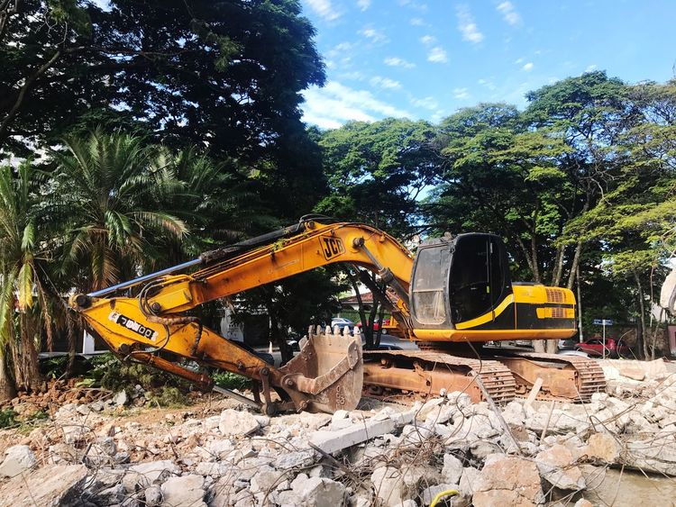 Earth Mover Tree Construction Site Construction Machinery Growth Day Machinery No People Digging Sky Outdoors