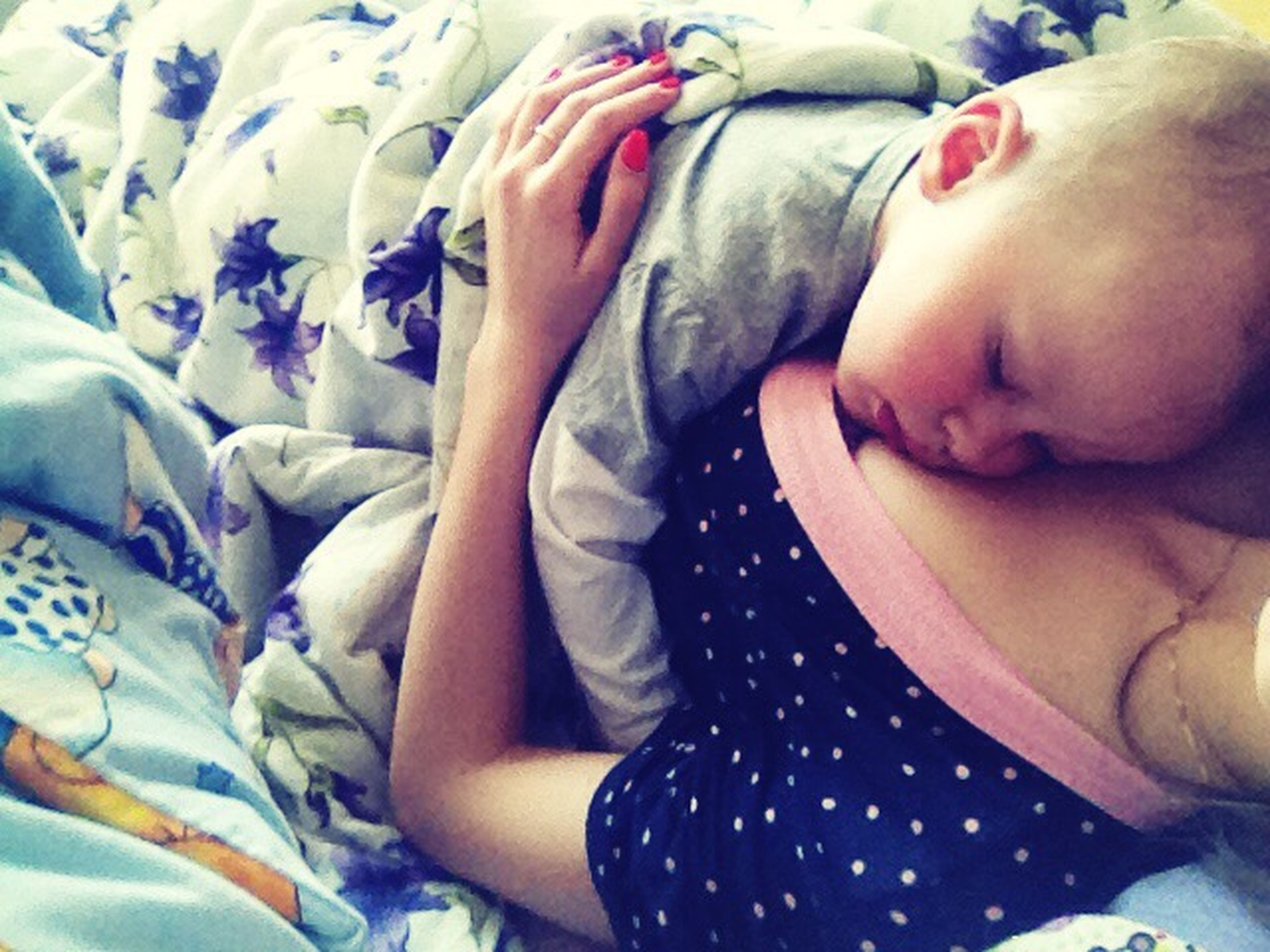 bed, relaxation, indoors, sleeping, lifestyles, baby, lying down, innocence, childhood, leisure activity, resting, babyhood, lying on back, unknown gender, togetherness, bonding, toddler, person
