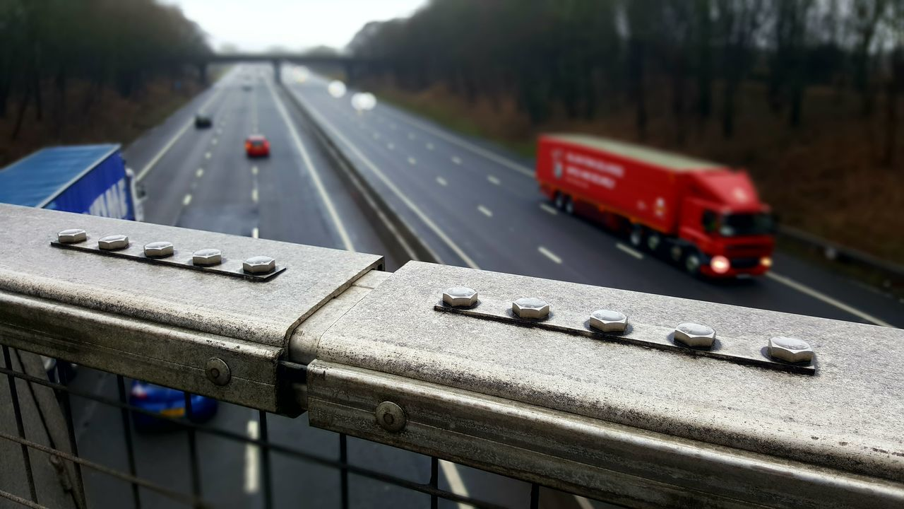 Metal Transportation Day Outdoors No People Close-up Border Safety Fence Bolts Geometry Uk Motorway Motorway View Lorry Trucks Fast Speed Background