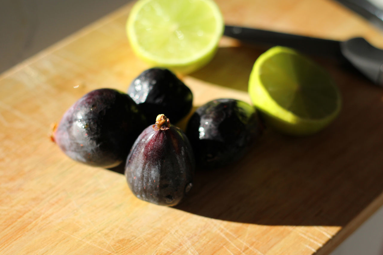 Figs and lime Breakfast Chopping Board Cocktail Cutting Board Eating Eating Healthy Fig Figs Food Food Preparation Freshness Fruit Fruits Halved Ingredients Lemon Lemons Lime Limes Sunlight Table