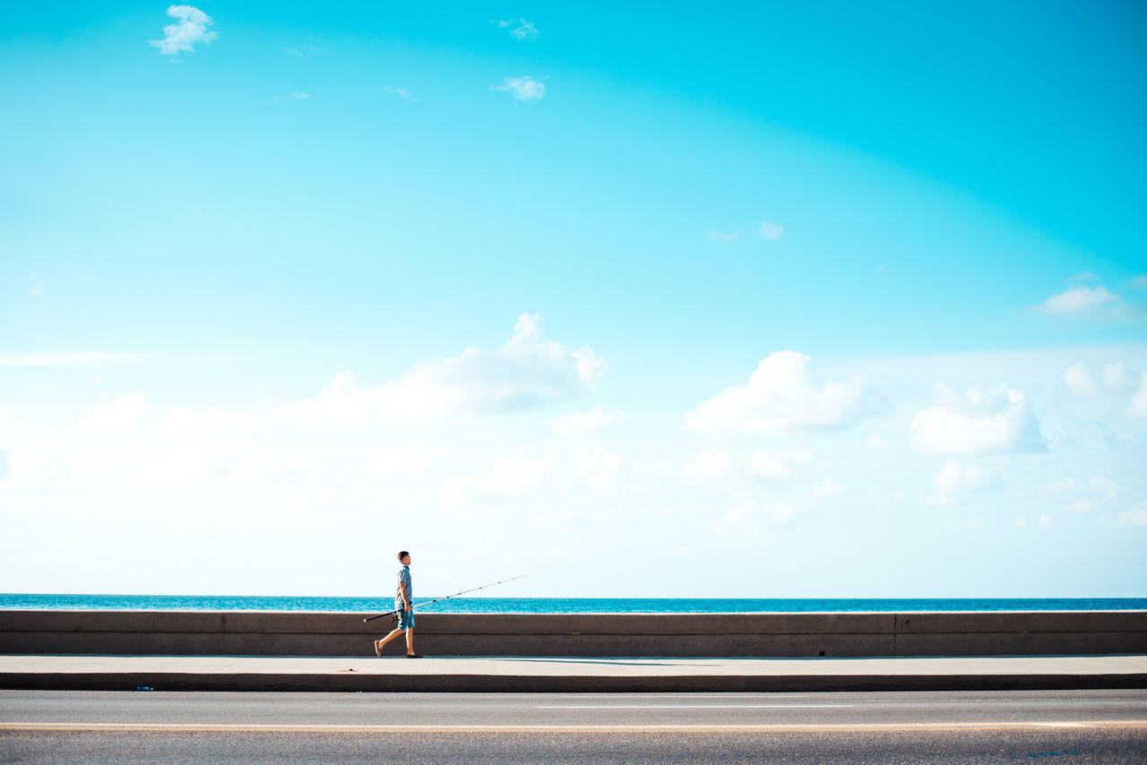 Off to fishing A Beauty In Nature Blue Cloud - Sky Cuba Day Fisher Fisherman Fishermen Havana Malecon Nature One Person Outdoors People Road Scenics Sea Sky Tranquil Scene Water