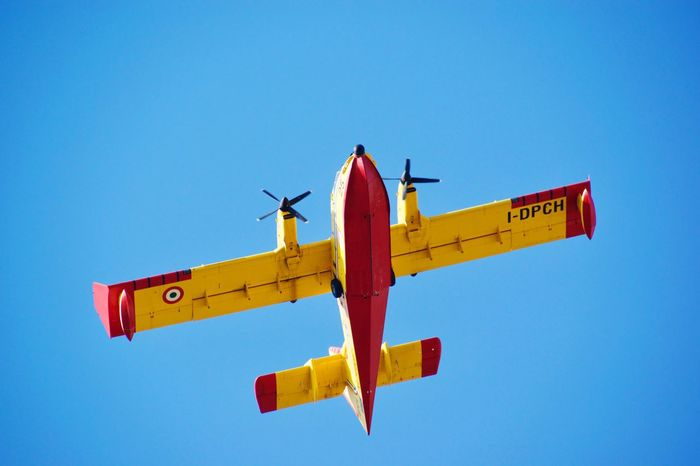Flying Airplane Transportation Air Vehicle Clear Sky Blue Low Angle View Outdoors Sky Day Mode Of Transport No People Airshow Fire Firefighter Fire Emergency