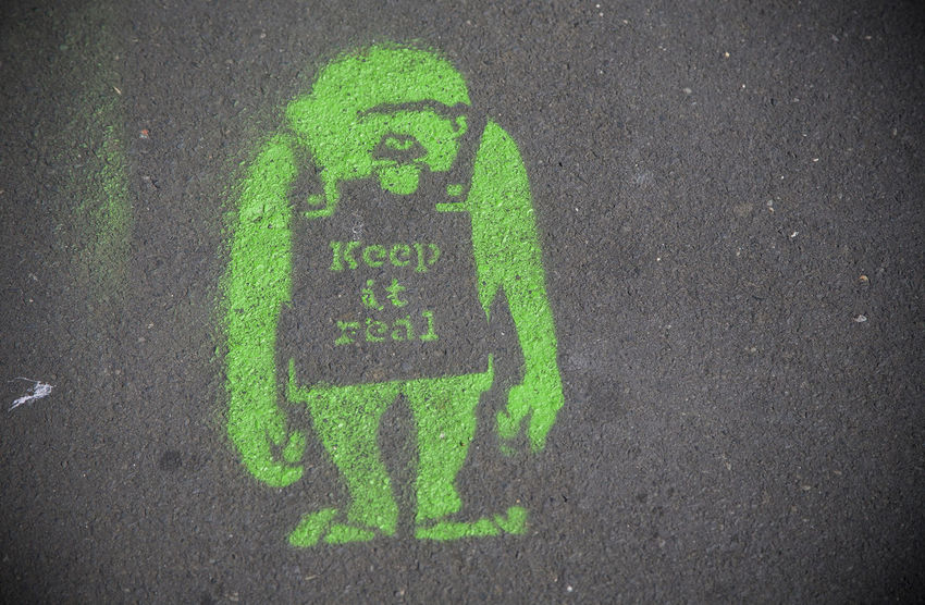 Keep It Real Ape Close-up Communication Green Color Keep It Real Monkey Outdoors Pavement Pavementporn Real Sandwich Board Street Symbol Tarmac Western Script