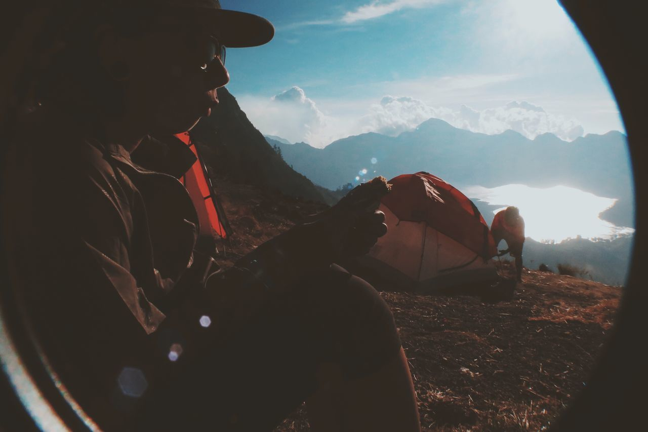 mountain, nature, adventure, one person, leisure activity, young adult, mountain range, lifestyles, young women, real people, women, beauty in nature, day, outdoors, friendship, sky, one young woman only, adult, people