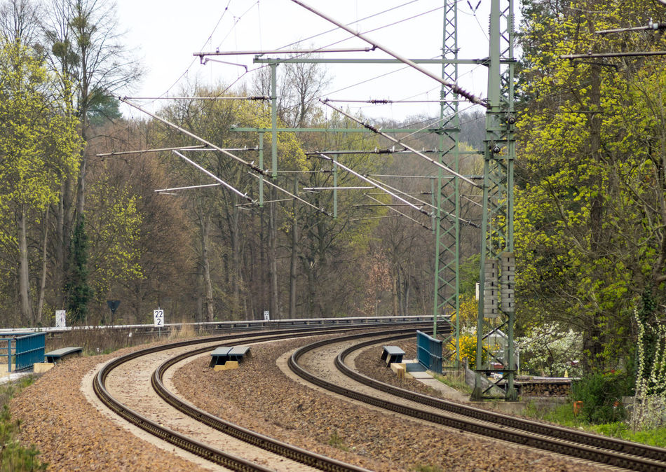 Beauty In Nature Cable Connection Curve Day Electricity  Electricity Pylon Fuel And Power Generation Logistics Nature No People Outdoors Power Line  Power Supply Rails Railway Schienen Sky Transportation Tree