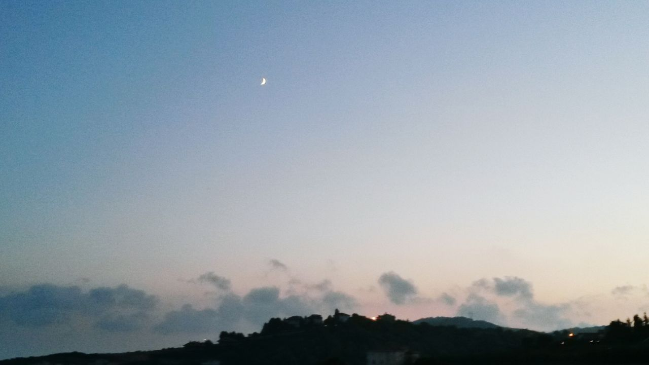 moon, sky, beauty in nature, nature, tranquility, scenics, tranquil scene, no people, silhouette, outdoors, half moon, crescent, tree, night, sunset, astronomy