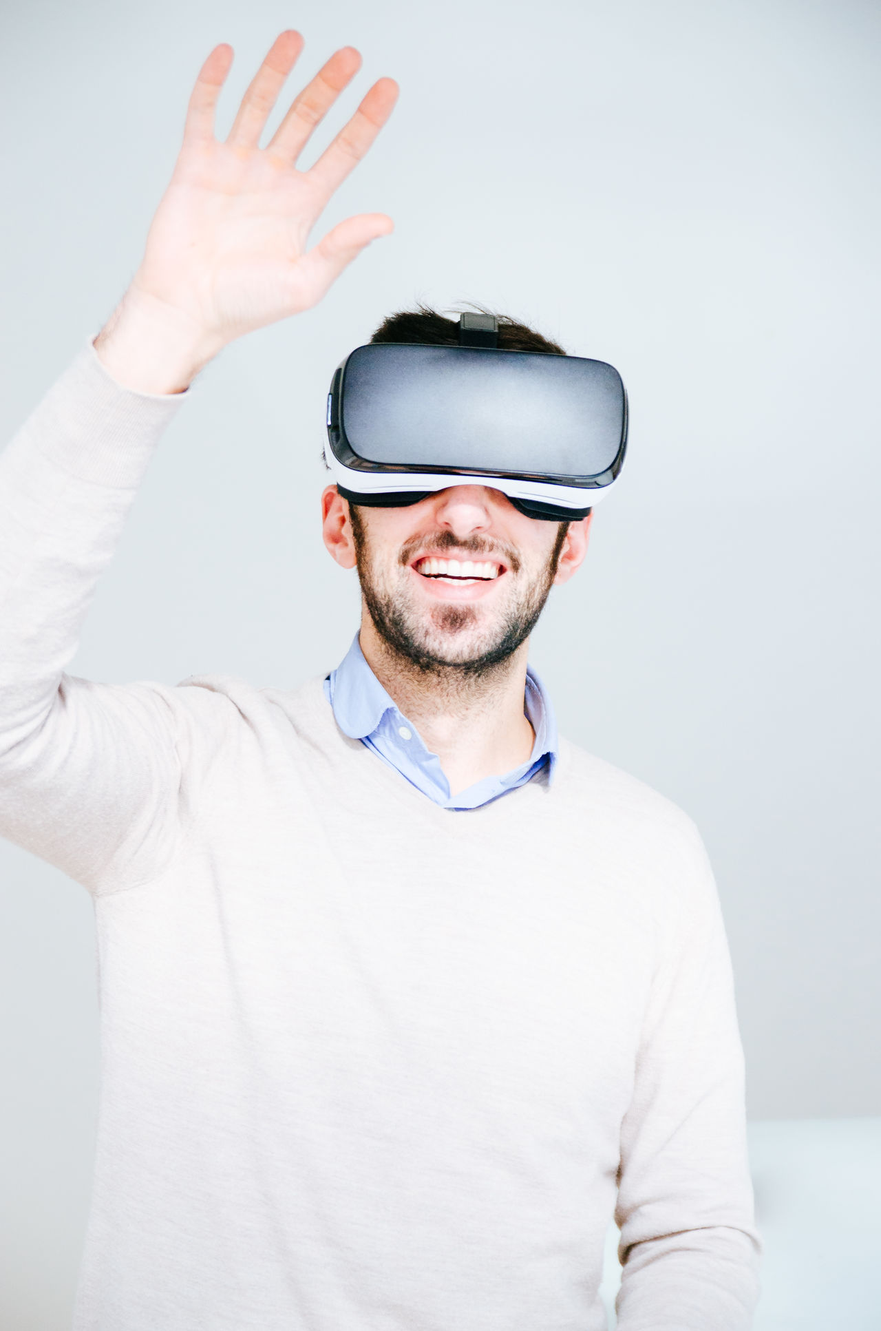 3-d Glasses Adult Adults Only Copy Space Cyberspace Enjoyment Futuristic Hand Raised Human Body Part Innovation Looking Men One Man Only One Person Only Men People Smiling Technology Virtual Reality Virtual Reality Simulator Vr Wearable Computer Wireless Technology