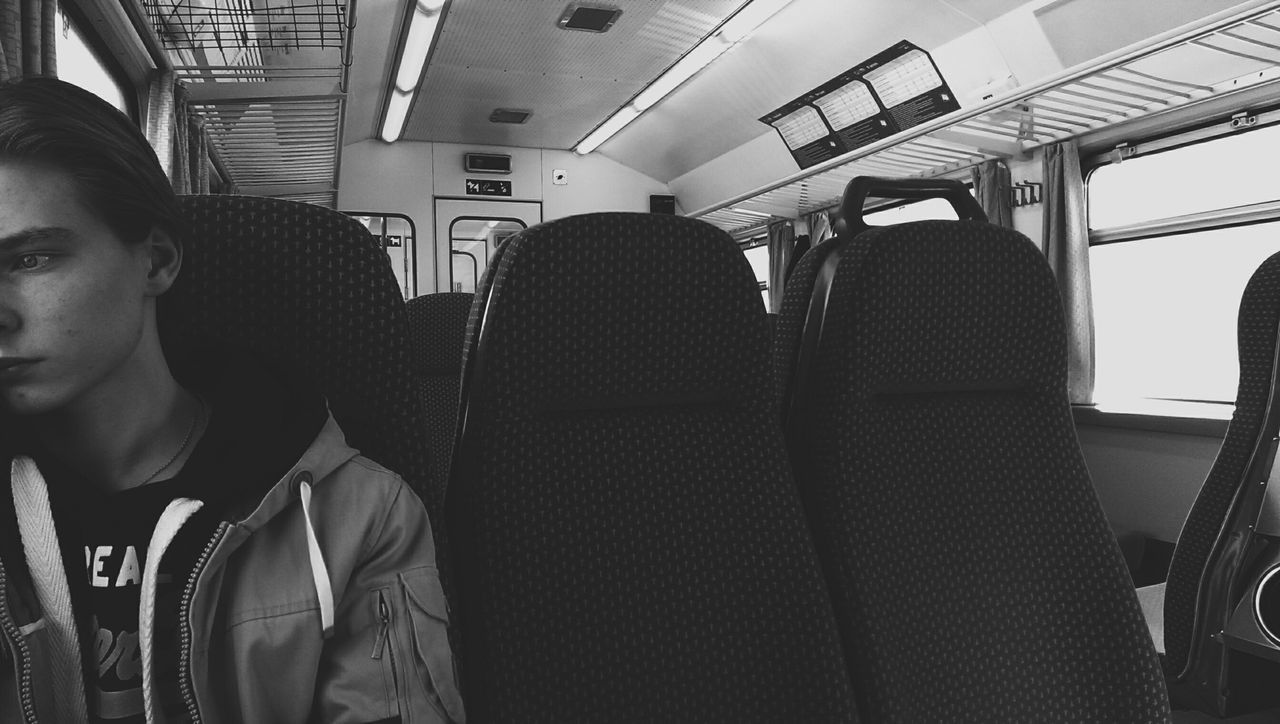 vehicle interior, transportation, vehicle seat, sitting, mode of transport, travel, indoors, public transportation, train - vehicle, one person, young adult, day, people