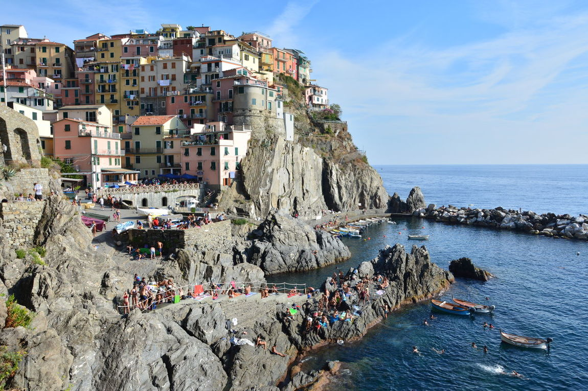 Dip Sea - A sunny afternoon at Manarola in Cinque Terre region, Italy. Beach Cinque Terre Italy La Spezia Large Group Of People Manarola, Outdoors People Scenics Sea Sky Summer Swimming Travel Travel Destinations Vacation Water Wave