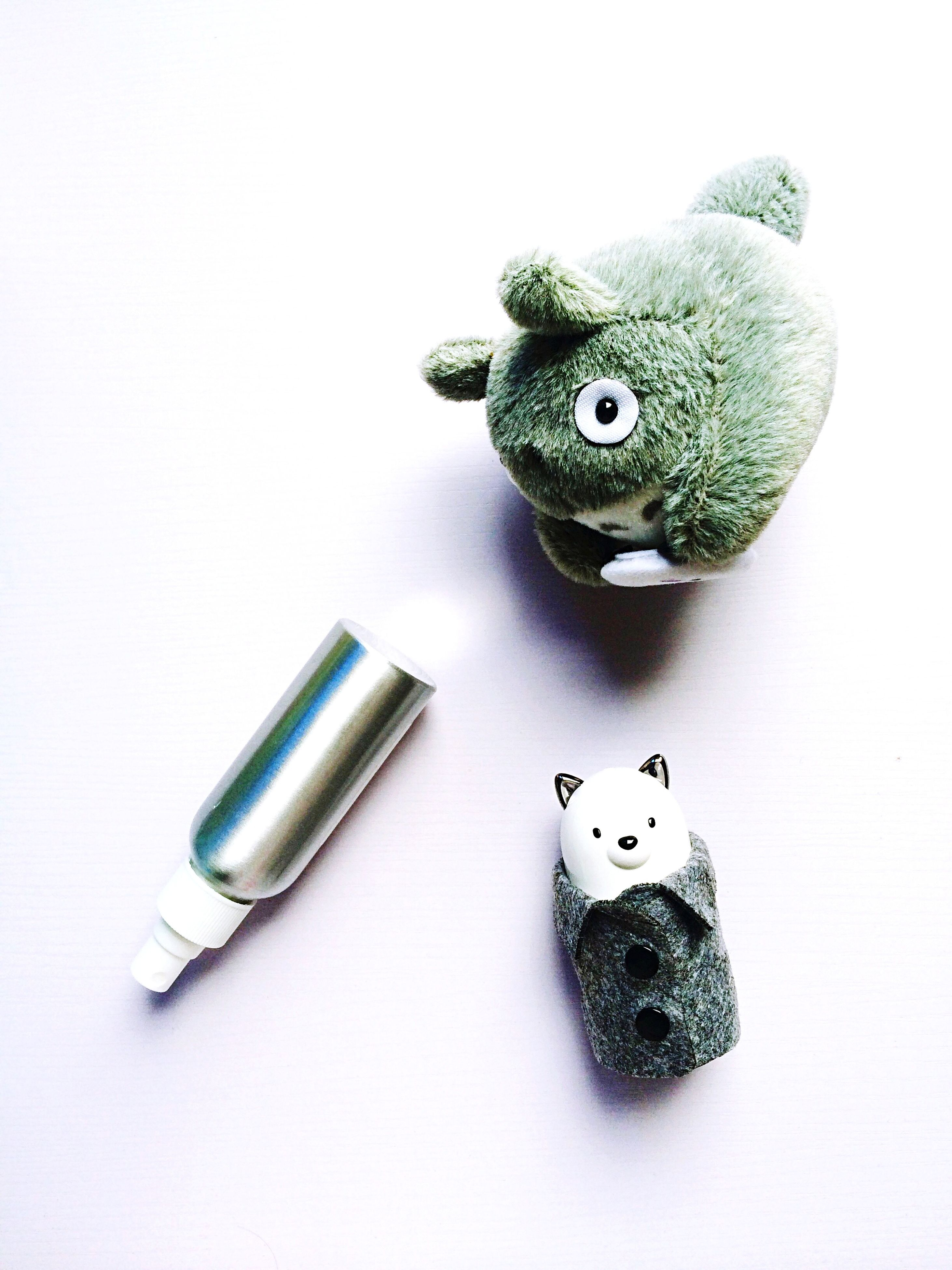 studio shot, still life, white background, toy, indoors, art and craft, animal representation, creativity, multi colored, art, variation, close-up, childhood, high angle view, table, stuffed toy, large group of objects, single object, copy space, pencil