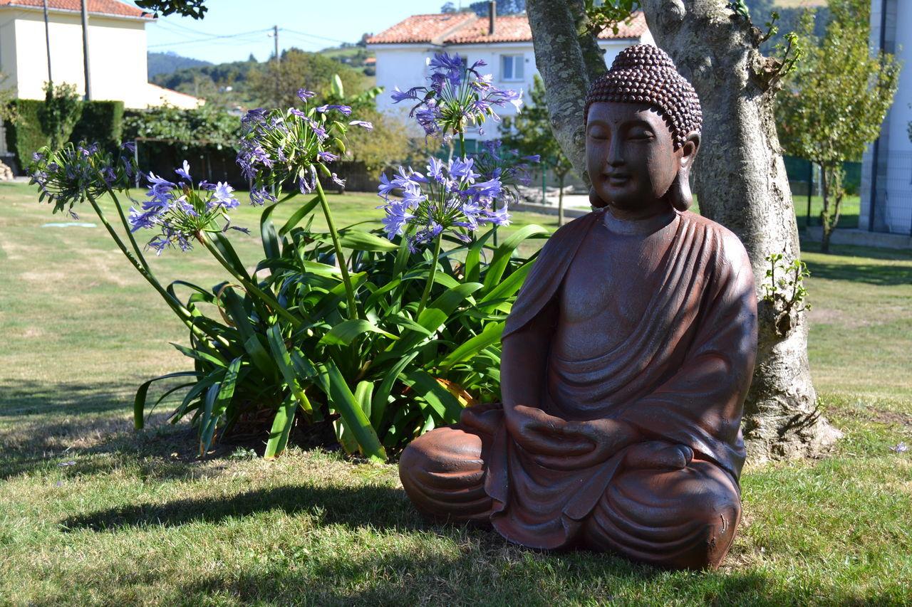 Buda Day Grass Growth Human Representation Nature Nature No People Outdoors Plant Plant Religion Sculpture Statue Tree Zen Zen Garden