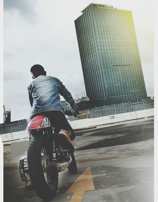 One Person Full Length Rear View One Man Only Adults Only Only Men Outdoors Cloud - Sky Railing Adult Men Day People Differing Abilities Young Adult Sky Headwear cafe race caferacerindonesia jakarta urbanjakarta