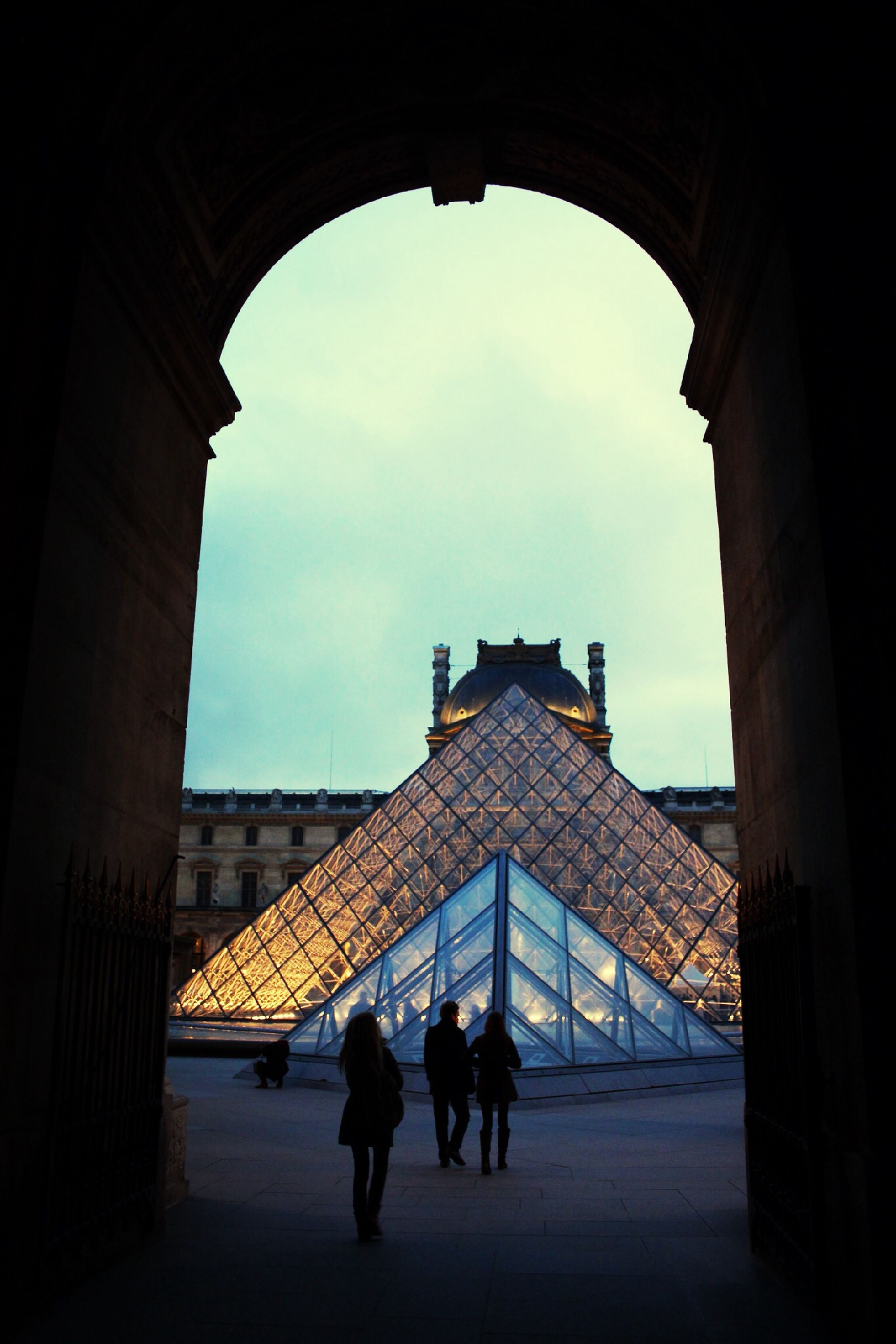architecture, built structure, arch, sky, building exterior, men, person, lifestyles, walking, silhouette, indoors, full length, history, leisure activity, standing, cloud - sky, tourist, famous place