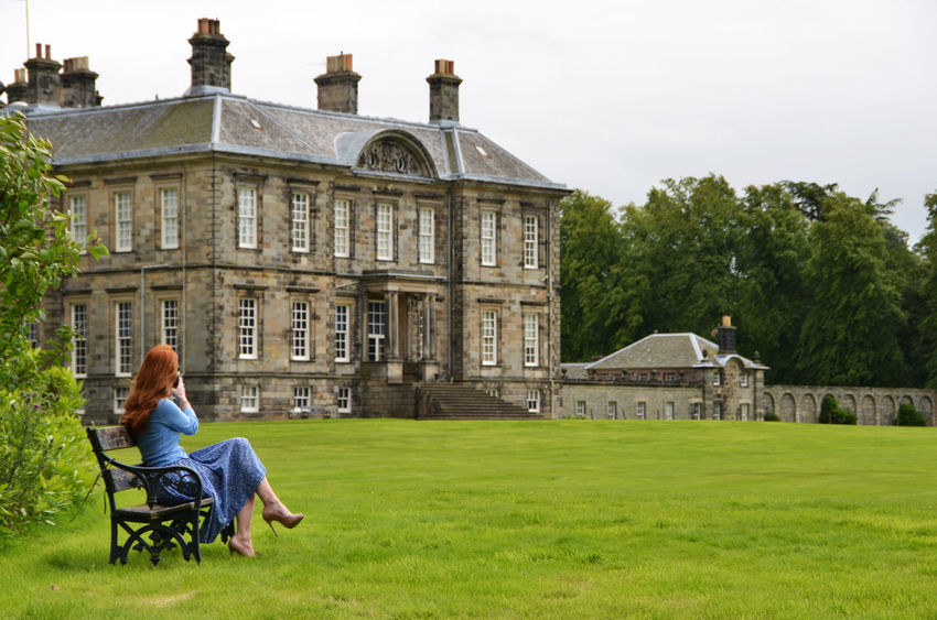 Architecture Bench Benches Built Structure Country House Countryside Fashion Fashion Photography Fashionblogger Fashionphotography Grassy Green Color Lawn Leisure Activity Red Hair Redhair Redhead Tourism Travel Destinations Tree Woman