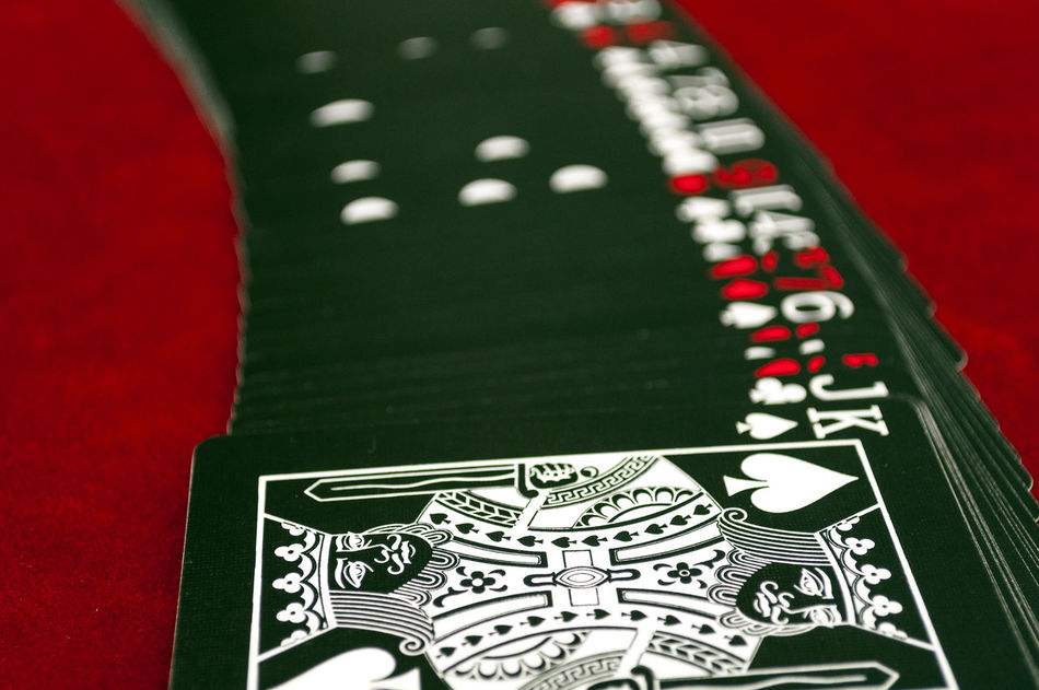 Deck of Playing Cards On Table with King Of Spades Black Cards Cards Game Casino Close-up Deck Gambling Indoors  King Spade No People Playing Cards Shuffle Suite Table