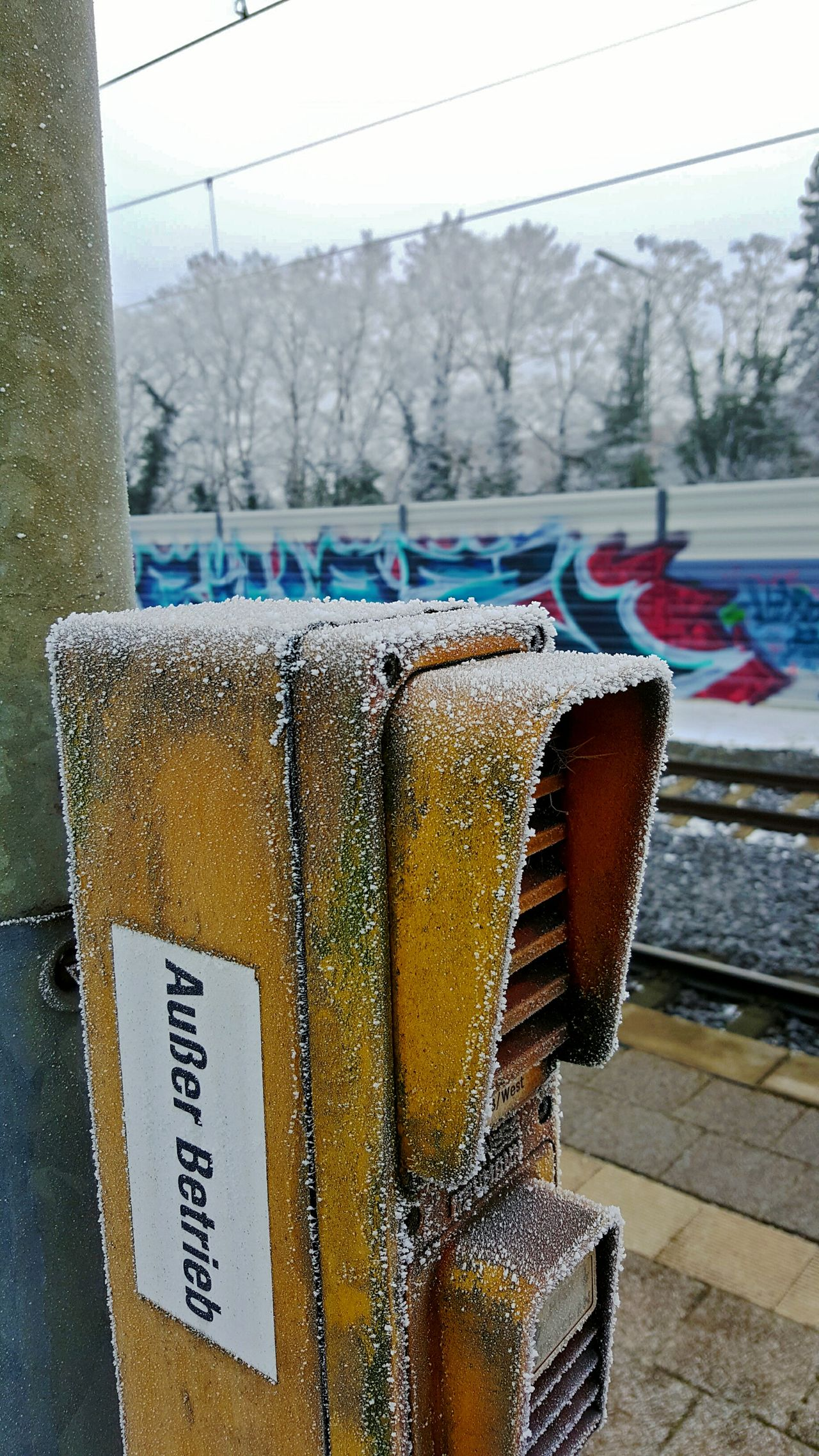 Call Comunication Obsolete Frost Old Telephone Train Station Cold Days Cold Outdoors Snow Graffiti Urbanphotography Streetphotography Objects Outoforder Wintertime Notavailable Information Sign Information Trees Railroad Rails PhonePhotography Phone