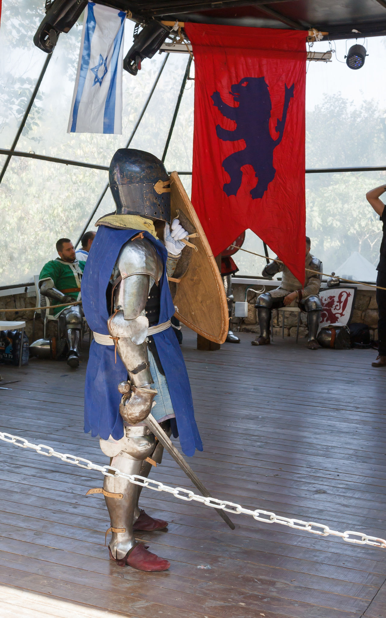 """Jerusalem, Israel, October 03, 2016: Member of the annual festival of """"Knights of Jerusalem"""" dressed as a knight standing in the ring ready to fight in Jerusalem, Israel Ancient Annual Attraction Christian Citizen Decorations Dressed Event Famous Festival History Holy Israel Jerusalem Knight  Land Medieval Member Old Performance Performs Photographer Pose Sword Tradition"""