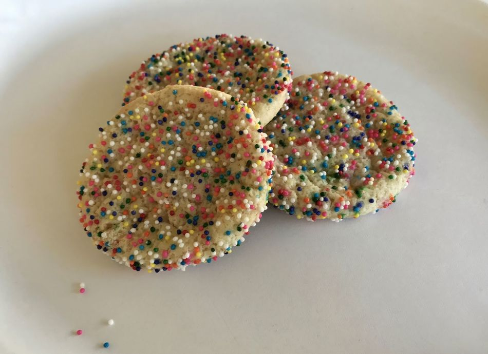 Sugar cookies topped with colorful nonpareils. Cookies Nonpareils Sugar Cookies Sweet Food Food And Drink Indulgence Sprinkles Still Life Unhealthy Eating Temptation Dessert Ready-to-eat Food High Angle View Indoors  Multi Colored Close-up No People Freshness White Background