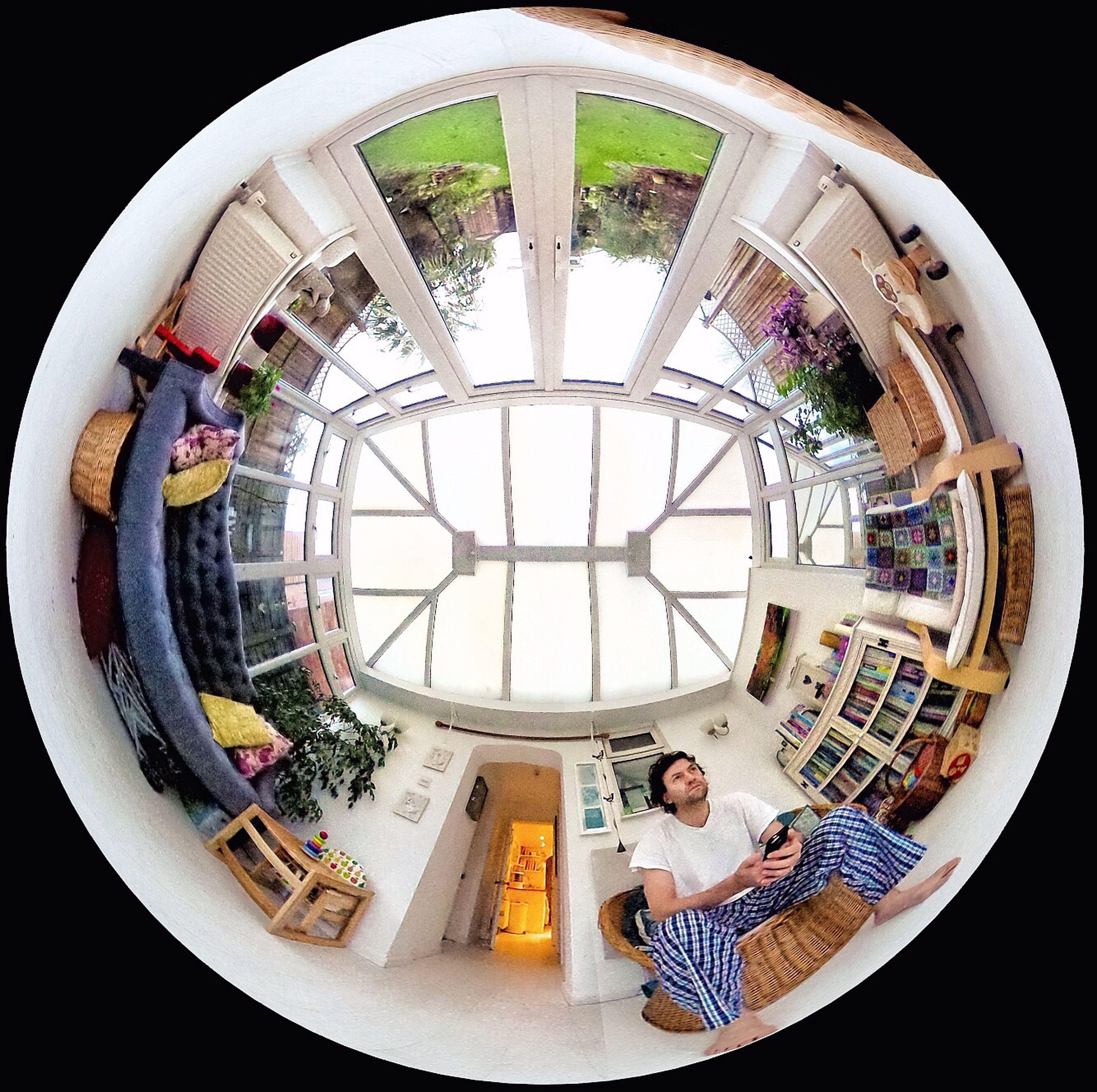 indoors, circle, built structure, architecture, geometric shape, low angle view, window, art, glass - material, arch, ceiling, day, pattern, multi colored, shape, creativity, art and craft, fish-eye lens, design, skylight