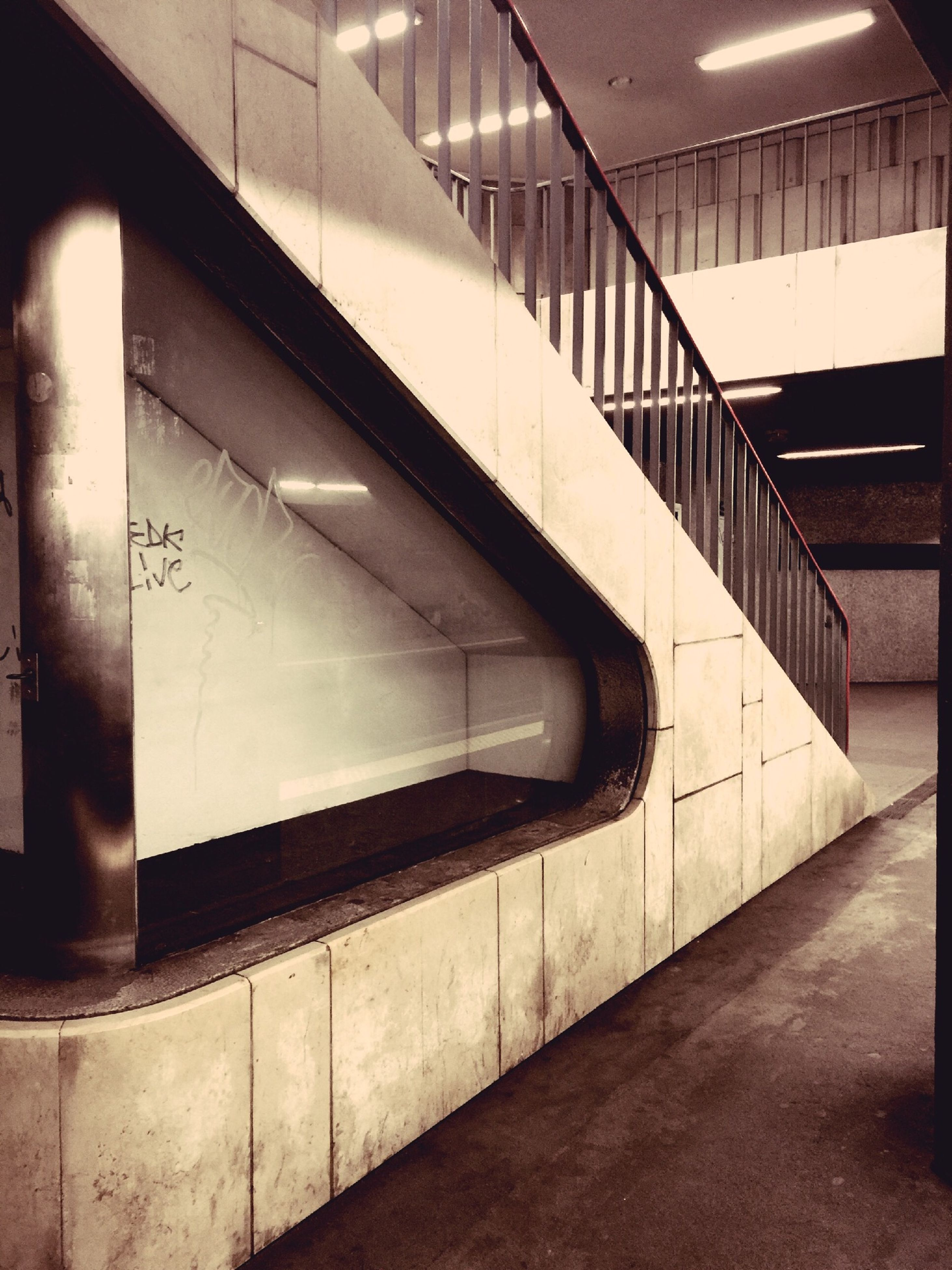 indoors, steps and staircases, steps, staircase, architecture, built structure, railing, wall - building feature, empty, flooring, building, subway, the way forward, absence, corridor, modern, no people, ceiling, illuminated, tiled floor