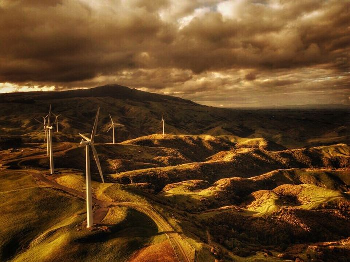 Windmill wind turbines Windmill Rural Scene Cloud - Sky Sky Landscape Nature Scenics Tranquil Scene Tranquility Beauty In Nature No People Mountain Outdoors Day Sunset Storm Cloud Windmill