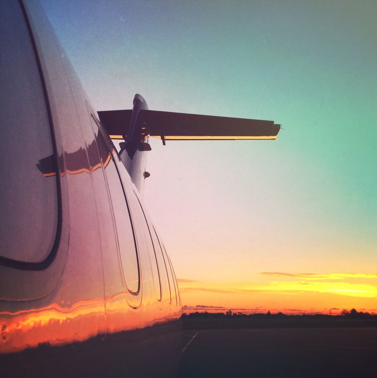 airplane, transportation, air vehicle, mode of transport, journey, flying, travel, sunset, sky, no people, outdoors, mid-air, nature, day, airplane wing, close-up