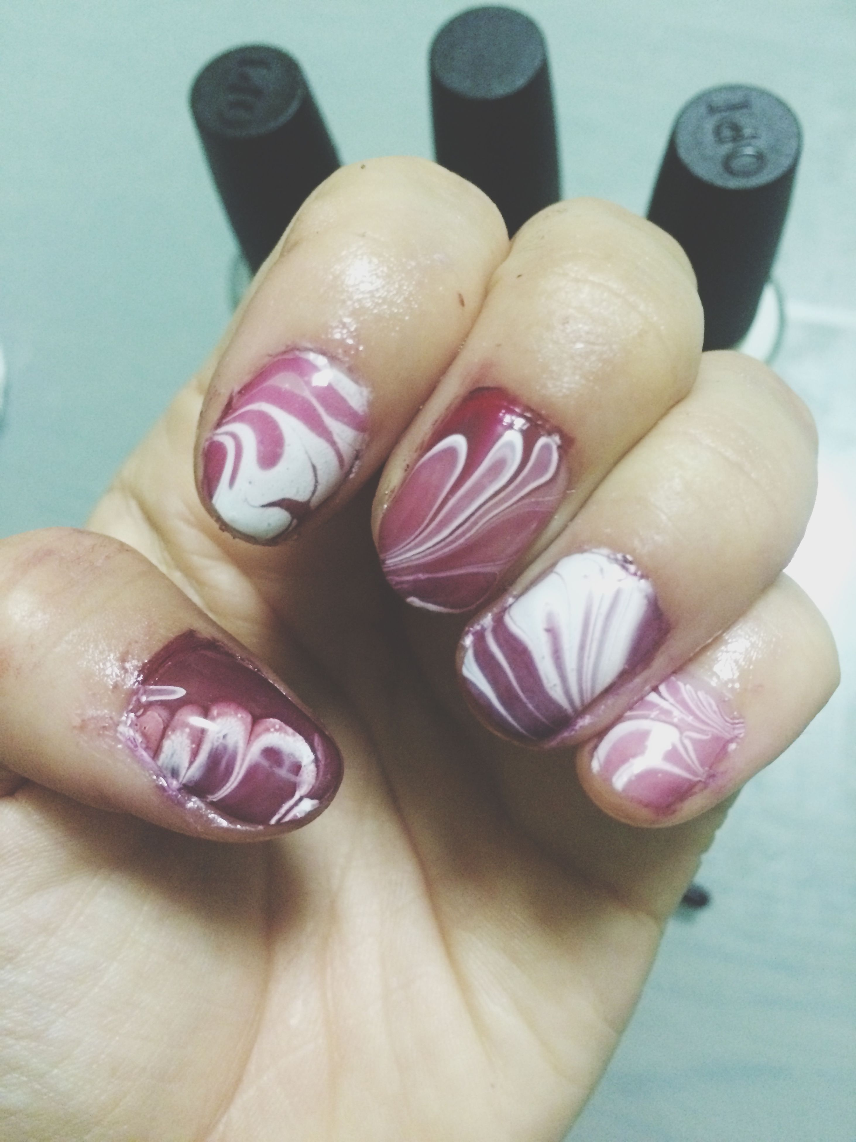 person, part of, close-up, holding, human finger, lifestyles, cropped, personal perspective, pink color, leisure activity, indoors, unrecognizable person, flower, nail polish, focus on foreground, showing