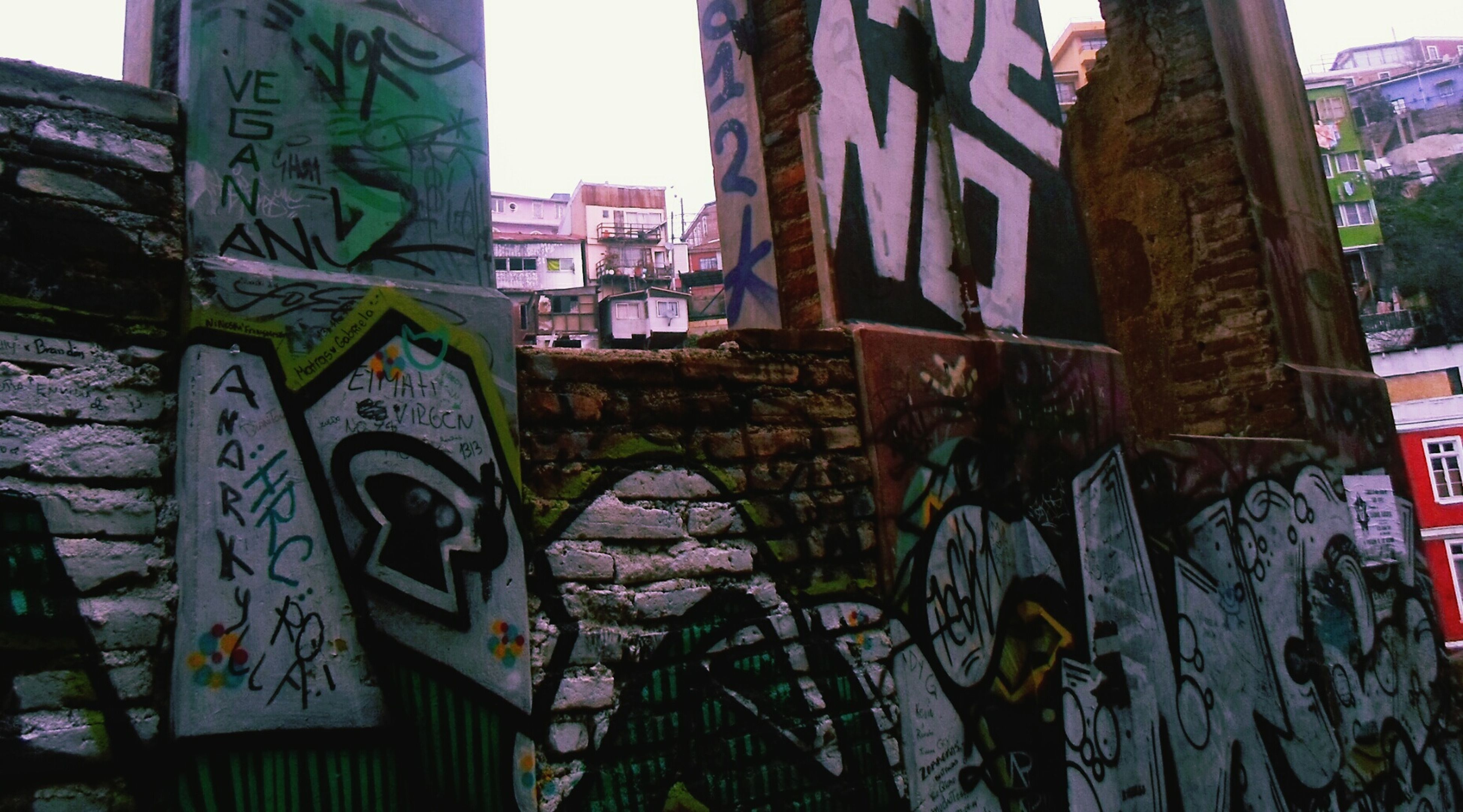 graffiti, architecture, built structure, art, creativity, building, street art, day, no people, outdoors, multi colored, city, sky