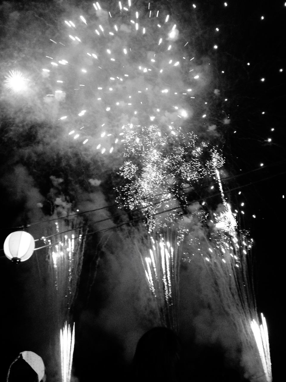 night, illuminated, celebration, firework display, glowing, lighting equipment, low angle view, firework - man made object, event, exploding, arts culture and entertainment, long exposure, firework, motion, no people, sky, outdoors, tree, close-up