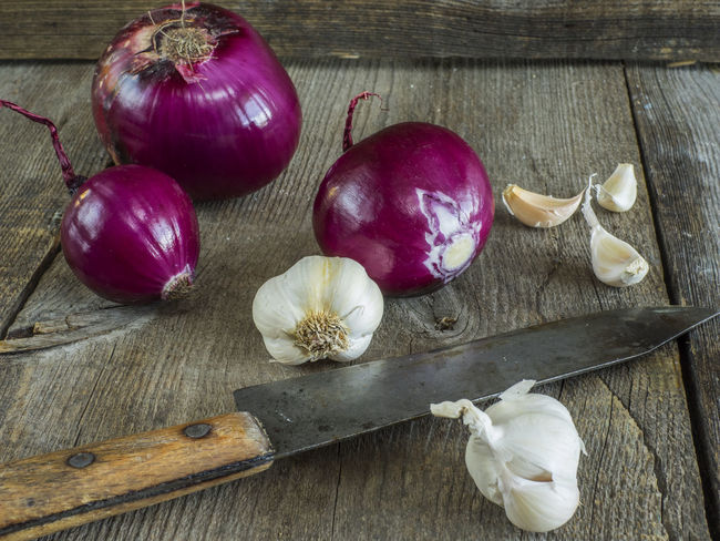 raw red onion and garlick on old weathered wooden background Background Close-up Food Food And Drink Freshness Garlic Garlic Bulb Garlic Clove Garlick Healthy Eating High Angle View Indoors  No People Old Onion Raw Red Still Life Studio Shot Table Variation Vegetable Weathered Wood - Material Wooden