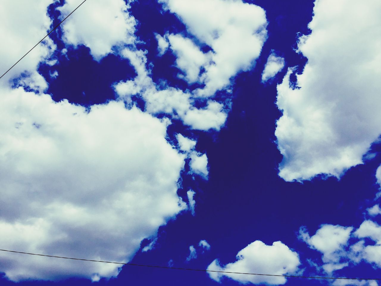 sky, cloud - sky, low angle view, nature, beauty in nature, day, outdoors, blue, no people, tranquility, scenics
