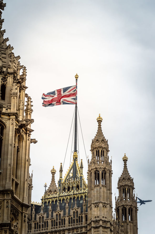 Tower with union jack flag in Parliament Houses in London Aircraft Architecture Brexit Building Exterior Built Structure City Cloudy Day English Flag Flags In The Wind  Gold Gold Colored History London London Life No People Outdoors Parliament Building Place Of Worship Sky Statue Travel Destinations Union Jack Westminster