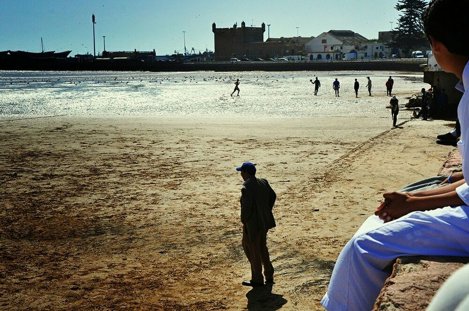 Football Fever Head Coach Observing People Playing Football Enjoying Life Localscene From Where I Stand Local Culture From My Point Of View Football Game Footballislife Sport In The City Sports Photography Light And Shadow Sun Reflection On Water Football Time  By The Sea On The Sand Football Pitch On The Beach Coach Watching Football Football Is Here - Morocco