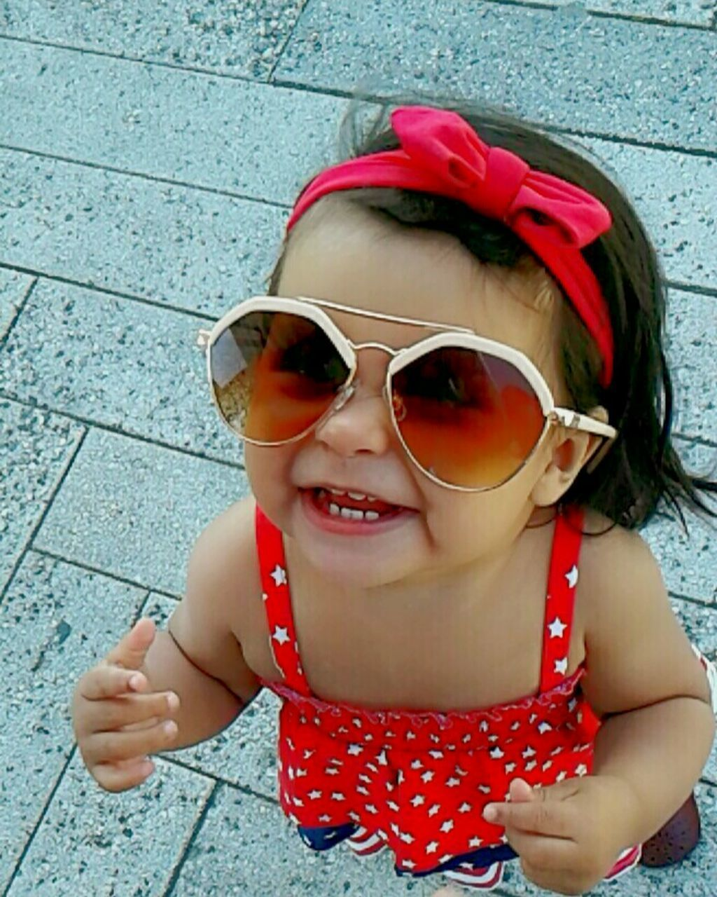 childhood, sunglasses, one person, girls, outdoors, real people, day, elementary age, portrait, looking at camera, lifestyles, child, people