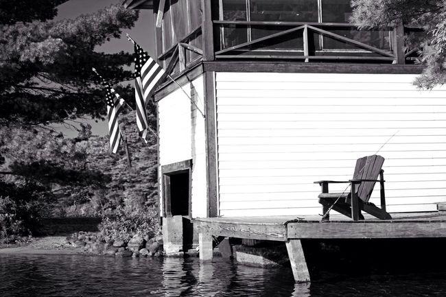 Lake Lakes  Water Boathouse Boat House ADK EyeEm Best Shots Boats New York B&w Sl1 Canon Blackandwhite Explore Amaturephotography Light And Shadow Photography Art America Fishing Chair Flags