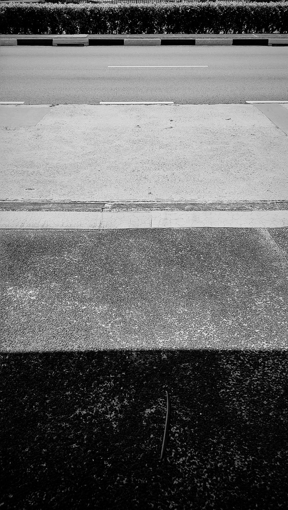 There are roads in this life that we all travel. There are scars and there are battles where we roam. When we are lost or wherever we may go, they will always lead you home. Singapore Roads Plain & Simple Black And White Contrast Rectangles Road To Nowhere Roadside Photography Singapore Road No Traffic