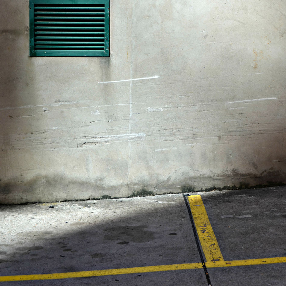 Soft Morning Light and Ground Shadow on Worn Concrete Wall with Battered Green Wall Vent and Yellow Line Marking Architecture Australia Backgrounds Brisbane Built Structure Close-up Concrete Texture Concrete Wall Full Frame Grunge Laneway Line Marking No People Outdoors Steffentuck Urban Urban Landscape Urban Photography Wall Wall - Building Feature Wall Shadow Worn Wall