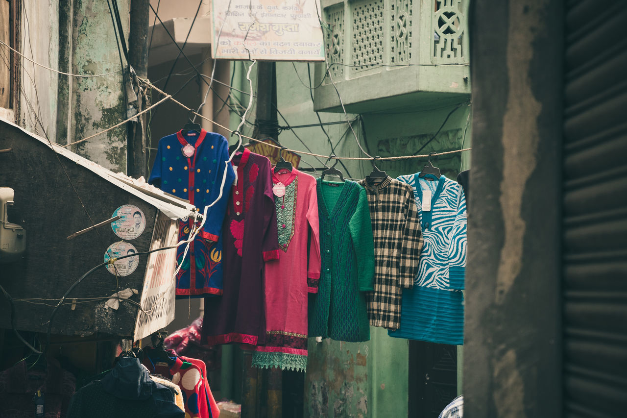 Architecture Building Exterior Built Structure Choice Cloth Clothesline Clothespin Clothing Coathanger Day Drying For Sale Hanging Laundry Multi Colored No People Outdoors Retail  Variation