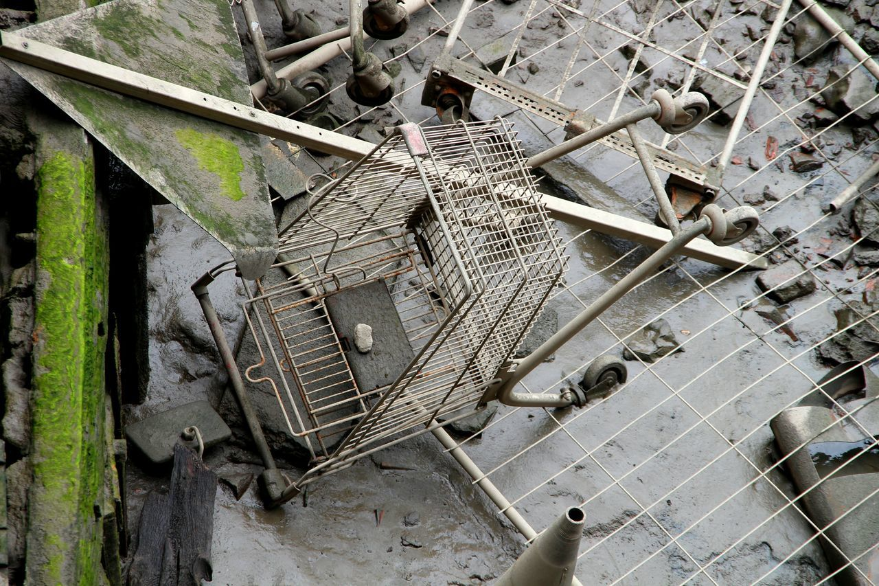 Flooded Shopping Cart And Road Sign