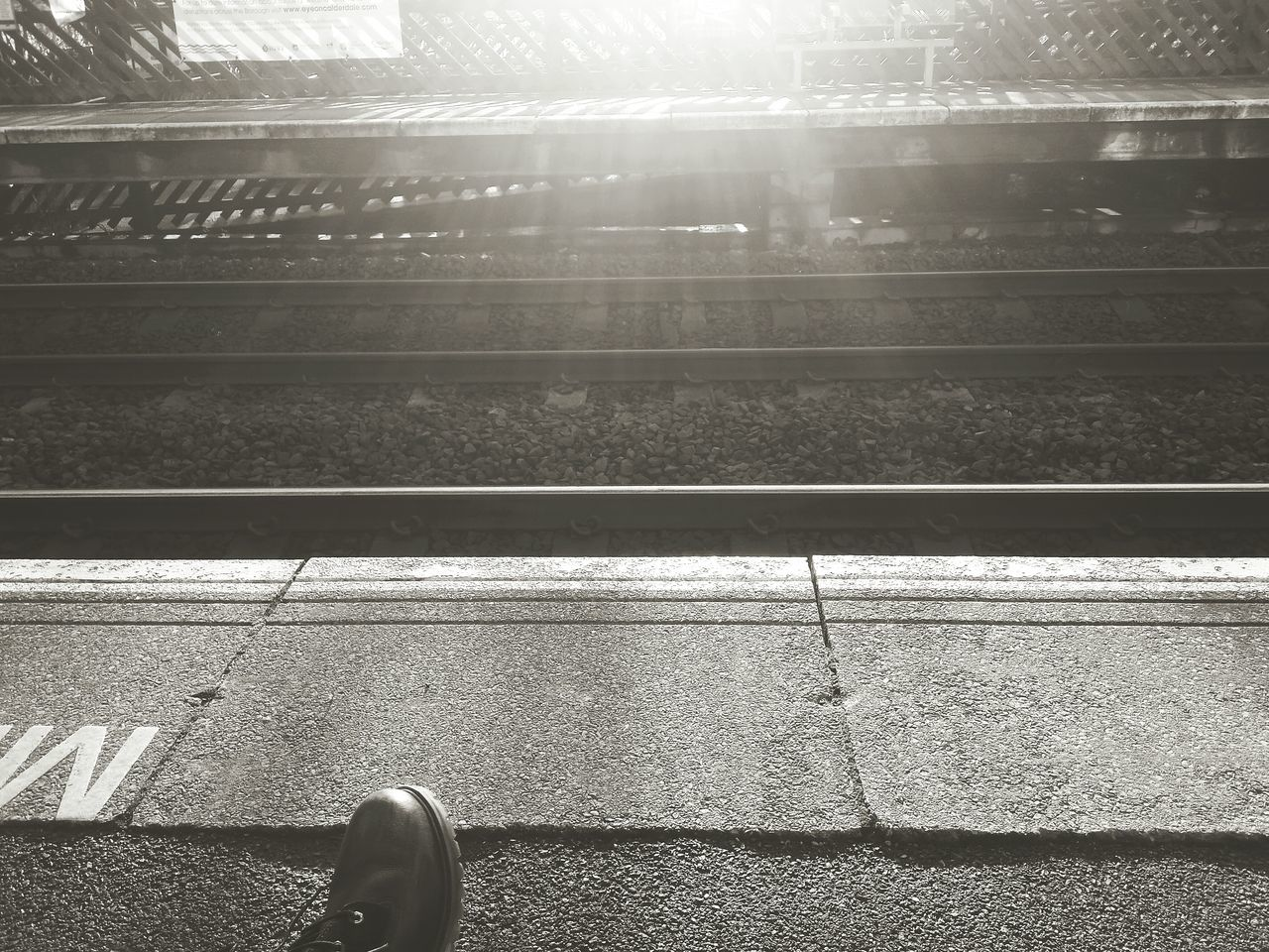 Monochrome Monochromatic Monochrome_life Waiting Portraits Black And White Portrait Train Station Black & White Black And White New Years Resolutions 2016 Christmas Around The World December Geometric Shapes Light And Shadow Glare Floortraits Train Tracks Tracks Platform Train Platform Boot Sat Down Feet Commuting Freelance Life