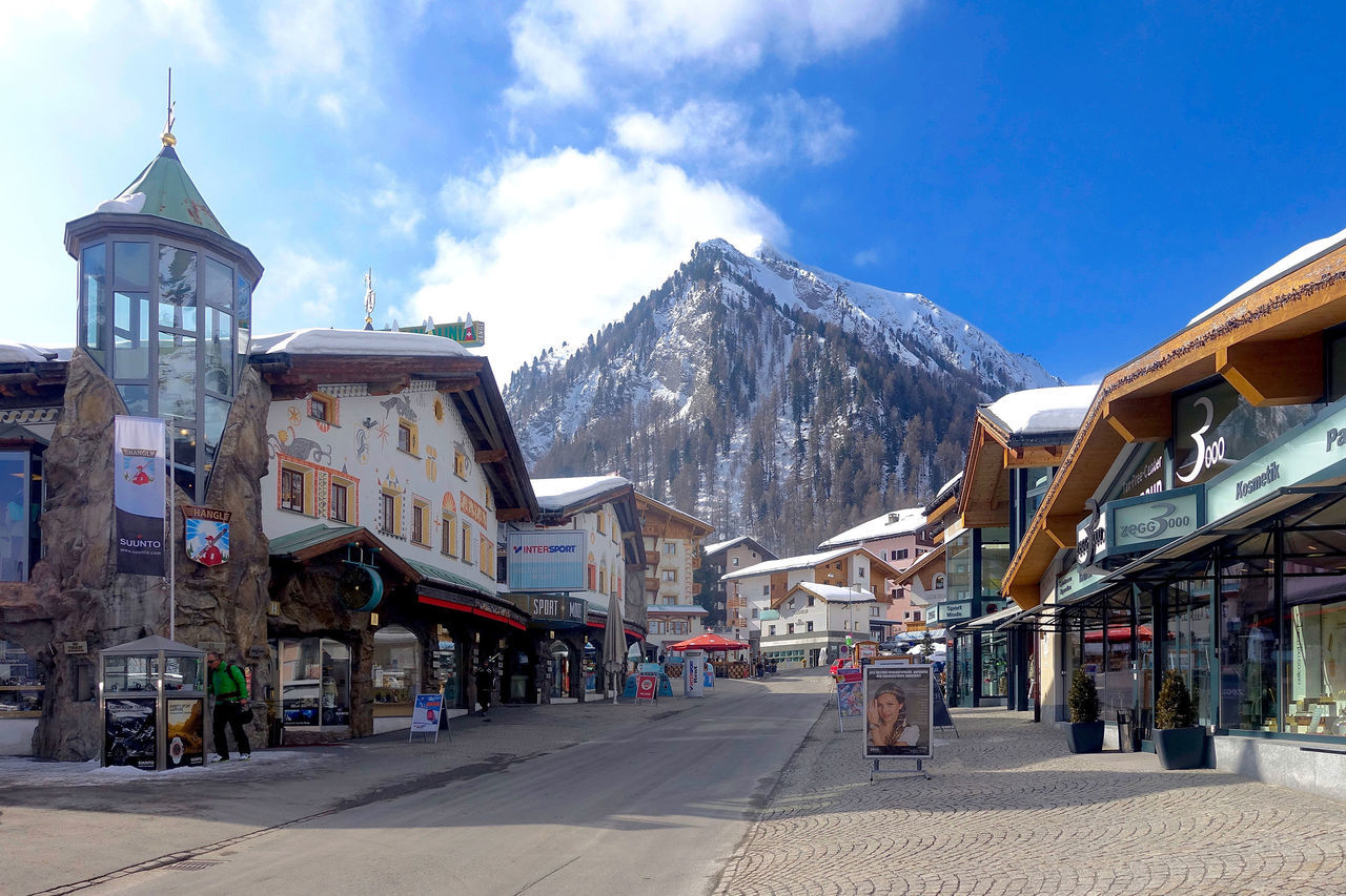 In the village of Samnaun are many shops, which sell goods duty-free. Architecture Blue Built Structure Cloud Day Duty Mountain Outdoors Road Samnaun Shops Sky Switzerland The Way Forward Travel Destinations Village