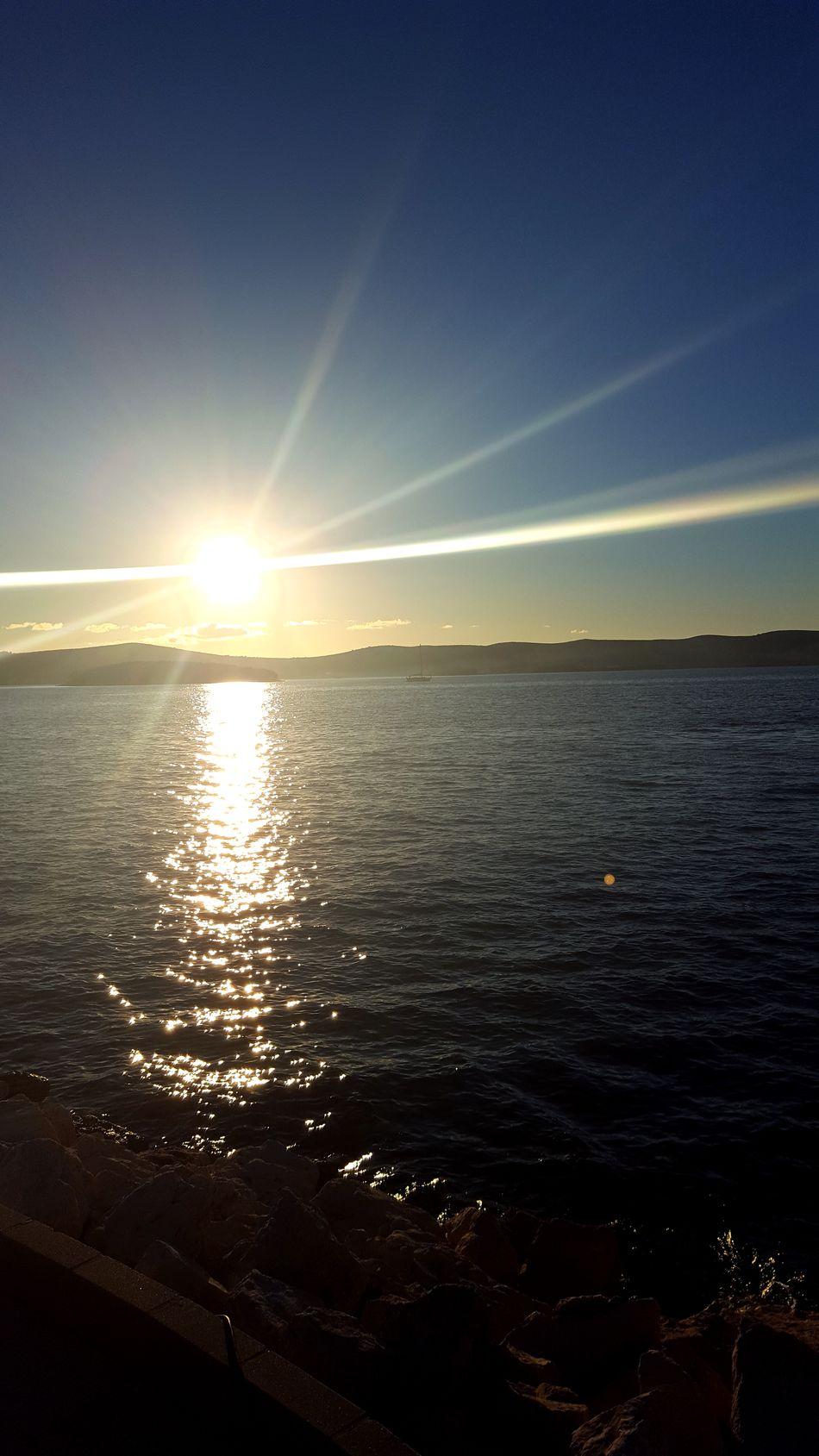 Reflection Sunlight Beauty In Nature Sea Horizon Over Water Nature Sunset Scenics Sky Water Sunbeam Outdoors No People Astronomy Sun Day Sunlight