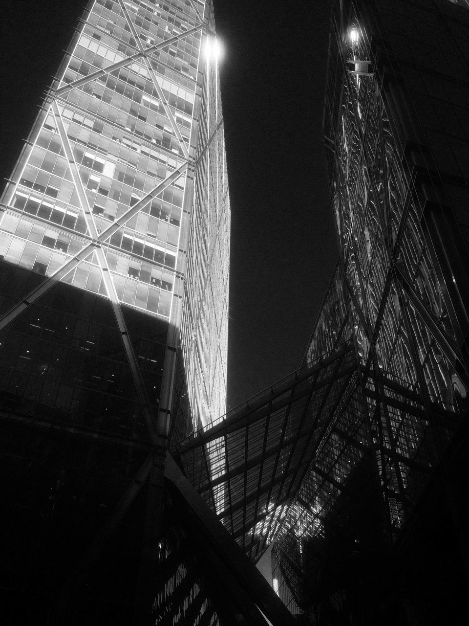 architecture, low angle view, built structure, illuminated, night, building exterior, no people, indoors, skyscraper, modern, sky, city