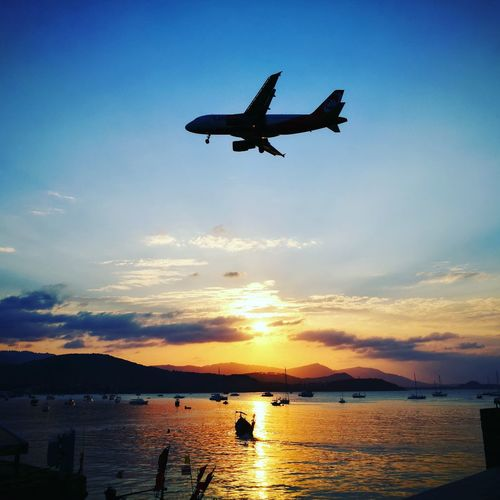 Sunset Koh Samui Sky Airplane Flying Travel Commercial Airplane Business Finance And Industry Beach Aerospace Industry No People Outdoors Water Day