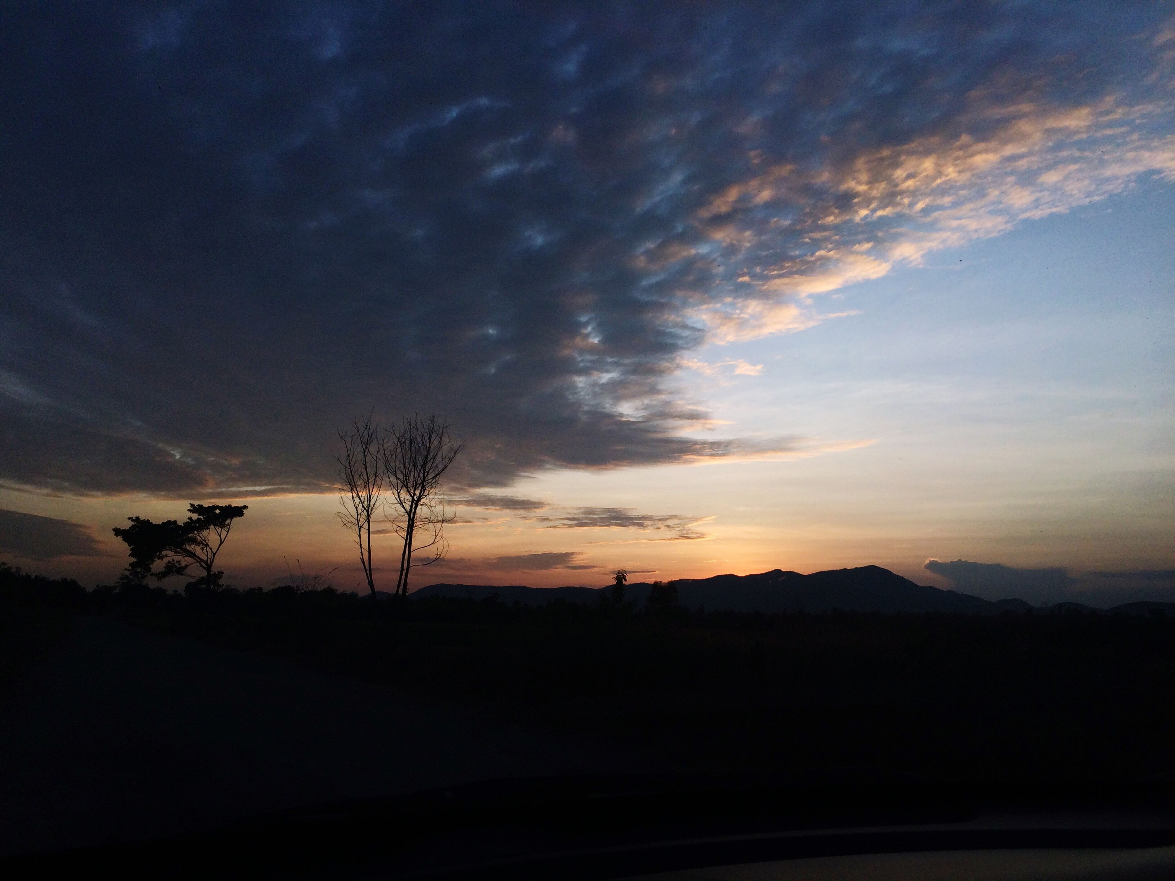 silhouette, sunset, tranquil scene, sky, scenics, tranquility, beauty in nature, landscape, cloud - sky, nature, mountain, idyllic, cloud, non-urban scene, dark, orange color, dramatic sky, dusk, tree, mountain range